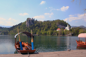A pletna sits on the shores of Lake Bled