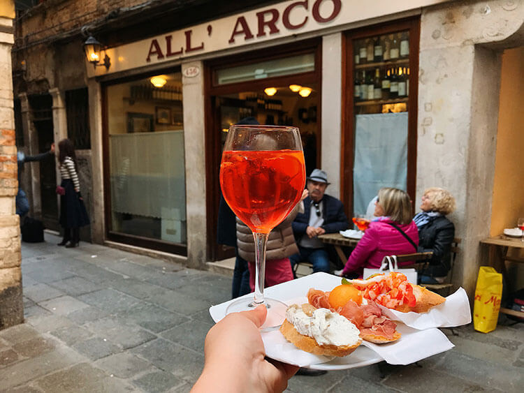 An aperol spritz and plate of cicchetti at All'Arco