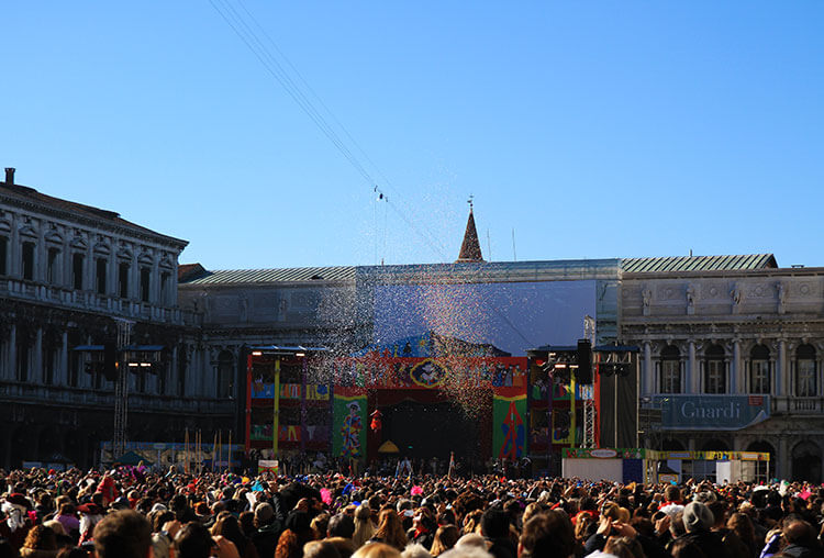 The angel arrives on the stage as confetti is set off in Piazza San Marco