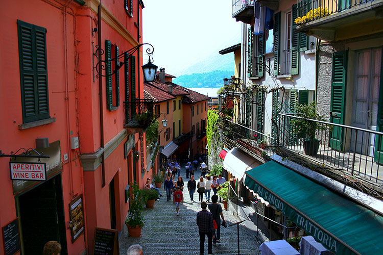 On a steep street in Bellagio old town looking down on Lake Como