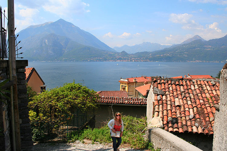 Jennifer climbing up the narrow streets in Varenna