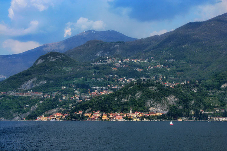 Varenna with the mountains towering above as seen from the ferry