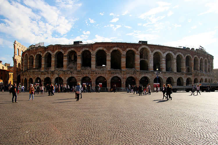 The full Arena di Verona seen from the edge of Piazza Bra
