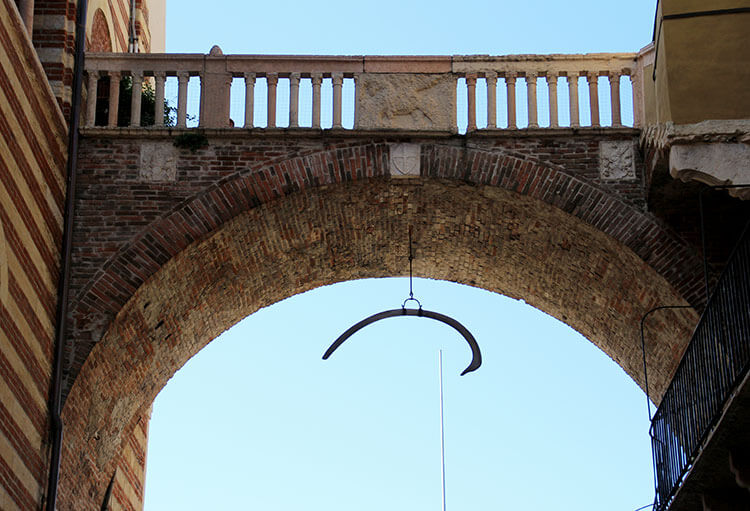 A whale bone is hung from the under part of the Arco della Costa in Verona