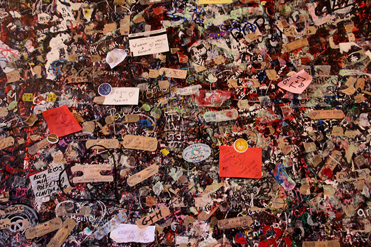 Every inch of a wall is covered in hundreds of thousands of love notes at Juliet's house in Verona
