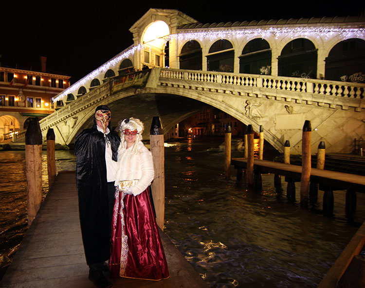 Me and Tim dressed up and posing in front of the Rialto Bridge
