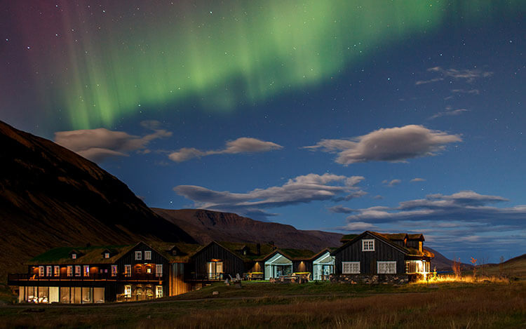The Northern Lights dance over Deplar Farm in North Iceland