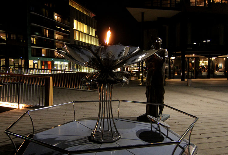 A metal scultpture shaped like a lotus flower holds the Eternal Peace Flame that is contiuously lit