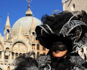 A black Columbina Venice Carnival mask