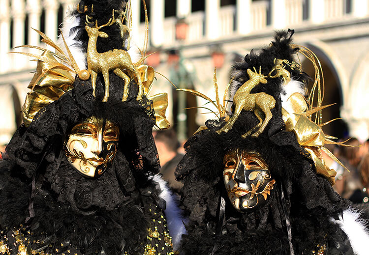 Black and gold masks with deer on the headdress