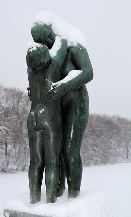 A sculpture of a naked woman and man embracing