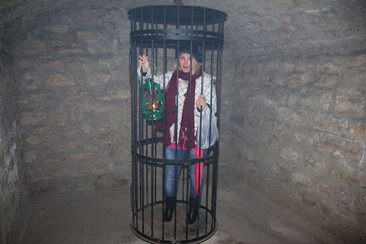 Tim trapping me in a cage in Buda Castle Labyrinth