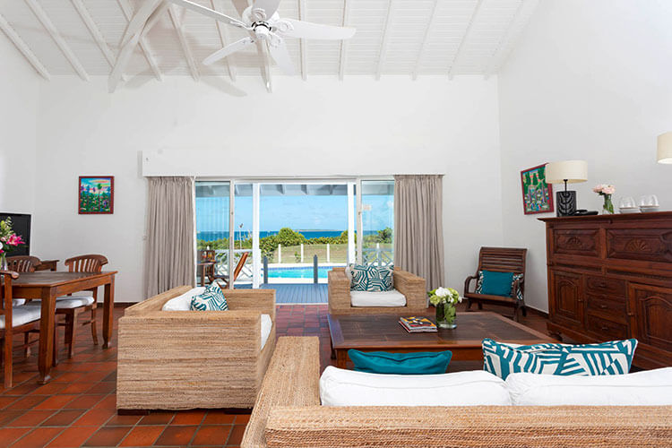 The presidential villa living room looking out to Orient Bay at Esmeralda Resort in Saint Martin
