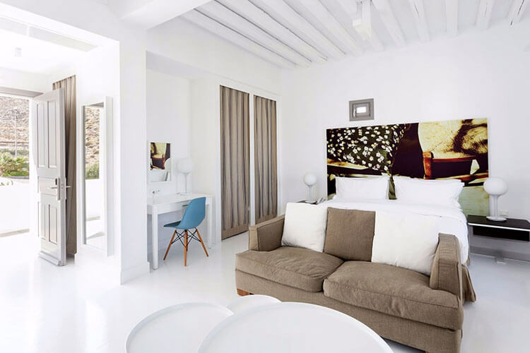 Our premier room decorated in whites and beiges with minimalist design desk and table