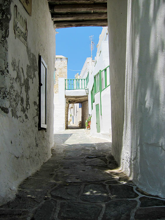 A narrow whitewashed alley in Chora, Folegandros