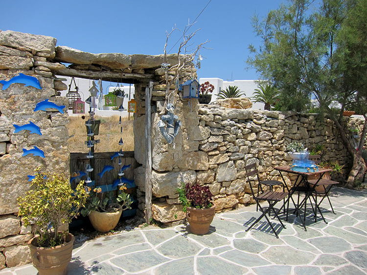 A restaurant with just one table set in a courtyward in Chora, Folegandros