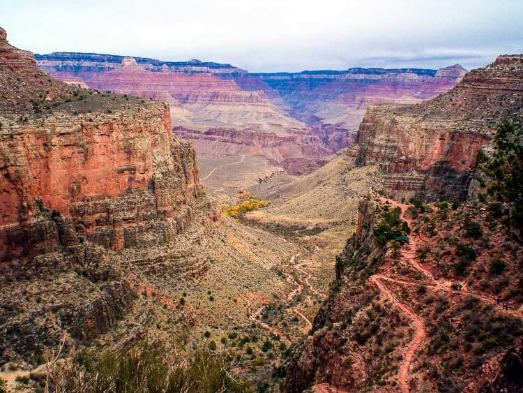 The Bright Angel is the Grand Canyons most popular trail. 3-mile resthouse is seen a top a section of switchbacks