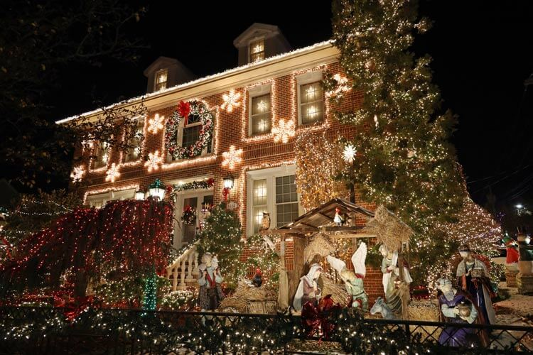 A life-size nativity with Mary, Joseph, baby Jesus, the three Wisemen and animals decorates the lawn of a Dyker Heights house in Brooklyn