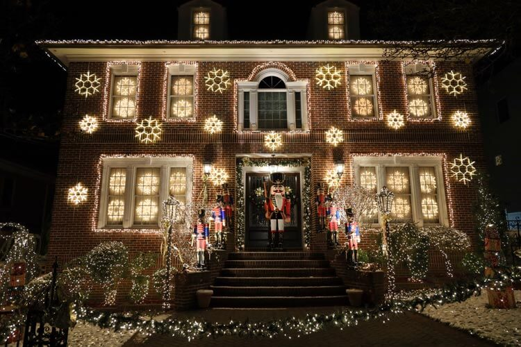The house is decorated with light up snowflakes and a life-size nutcracker in Dyker Heights, Brooklyn
