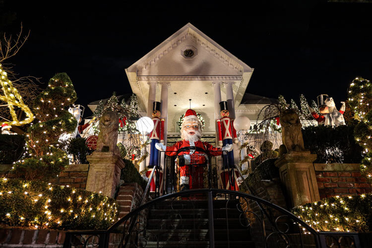 The Polizzottos Toy Land house in Dyker Heights with a 20-foot tall animatronic Santa Claus, toy soldiers and carousel in Dyker Heights, Brooklyn