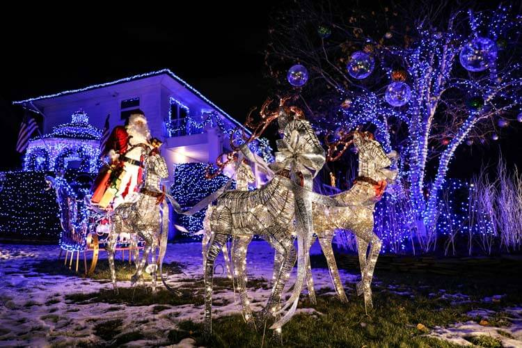 A life-size Santa on a sleigh with reindeer on the lawn of a Dyker Heights home in Brooklyn, New York