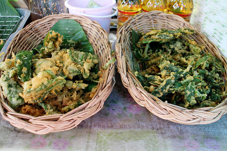 Two baskets of fried Thai basil at the Taling Chan Floating Market