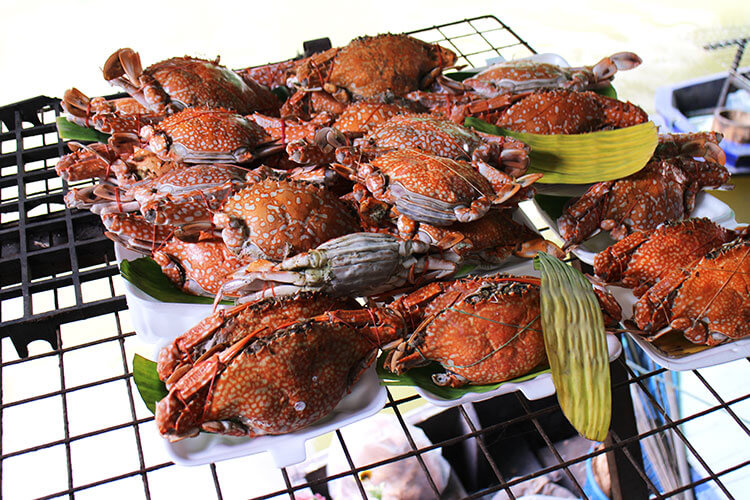 Crabs that have been steamed and ready to serve on banana leaves at Taling Chan Floating Market