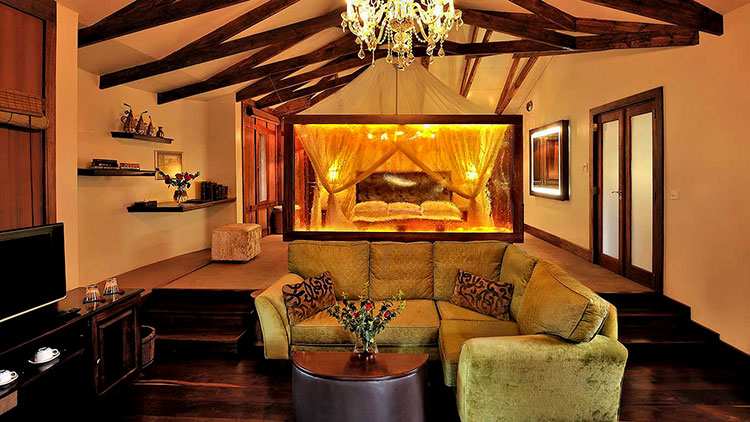 Our plantian suite with green and gold interiors and dark wood at Arusha Coffee Lodge