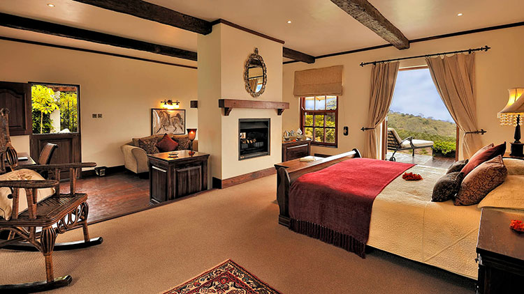 The cottage suites with a dual-sided fireplace dividing the bedroom from the sitting area