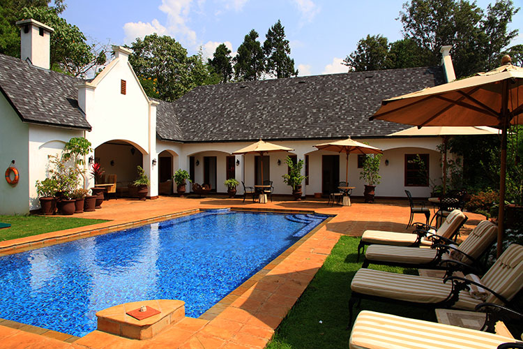 The pool and building that houses the spa at The Manor at Ngorongoro