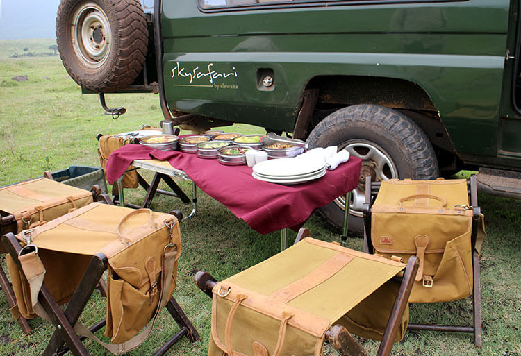 Our bush picnic lunch set up on a table with camp chairs
