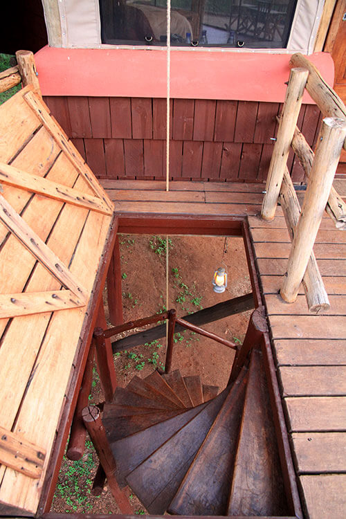 The trap down and spiral staircase to access the tree houses at Tarangire Treetops