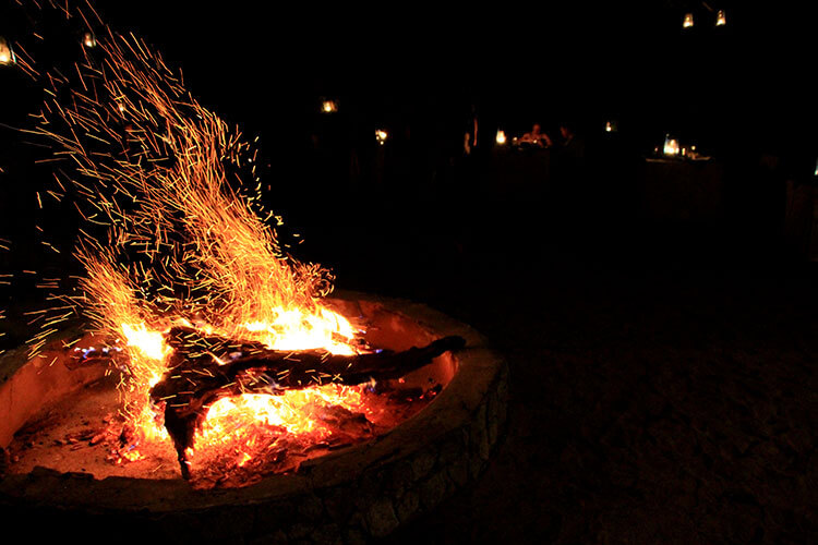 A fire in the firepit of the boma at Tarangire Treetops