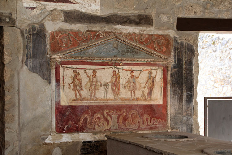 A large frescoe of Pompeiian warriors decorates the wall of the Thermopolion in Pompeii