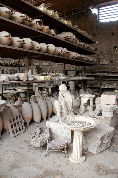 Archaeological artifacts from pottery to people preserved in the lava are seen in the Grain Stores at Pompeii