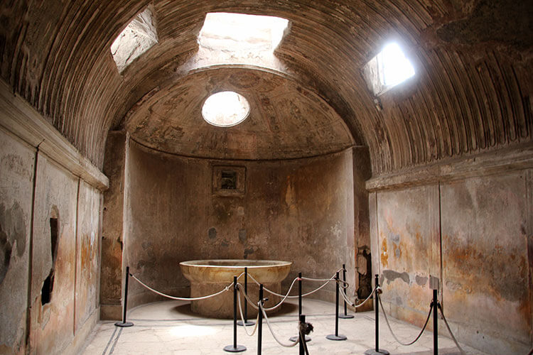 The inside of the Forum Baths where we see the tub of the hot water bath
