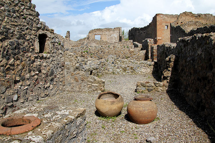 Two pots sit in ruined rooms of the Comitium at Pompeii