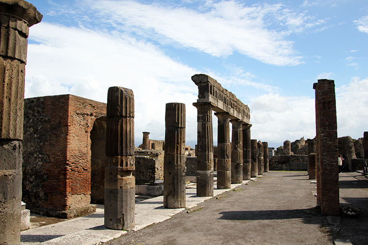 Columns lins the pedestrian street of the Forum in Pompeii