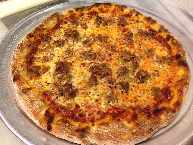 "The ""New York Slice"" with Pizza School NYC's homemade sausage"