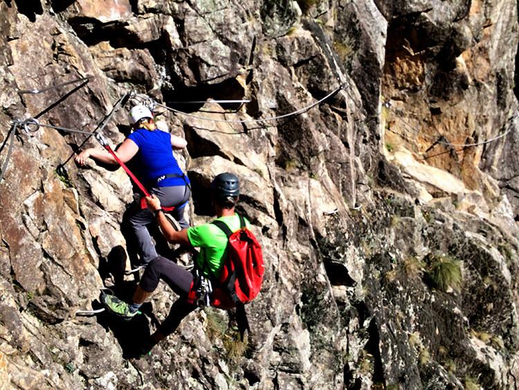 Jennifer and the guide navigate a section of the cliff face of Via Ferrata du Pont du Diable