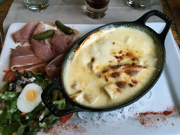 Tartiflette served with salad
