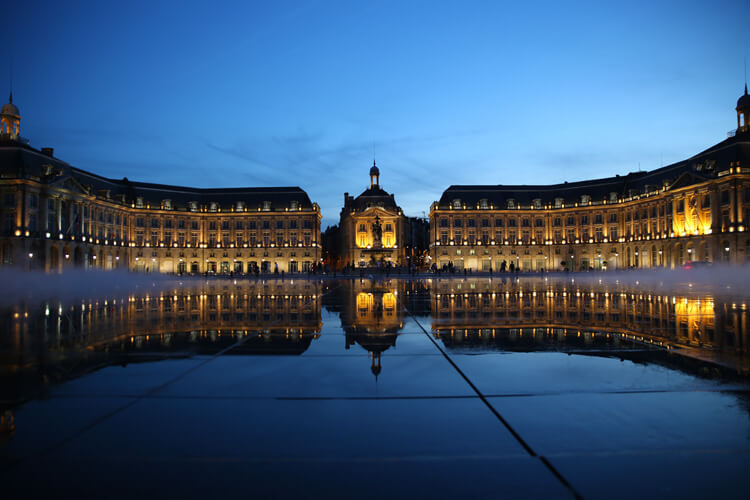 Place de la Bourse is reflected on the Water Mirror at blue hour