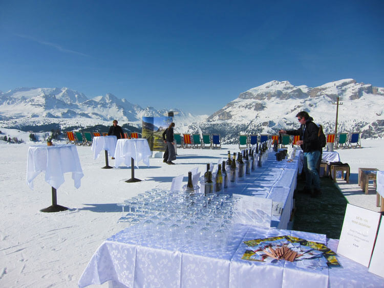 A table set up with wine glasses and bottles of Alto Adige wine for tasting on the Wine Ski Safari