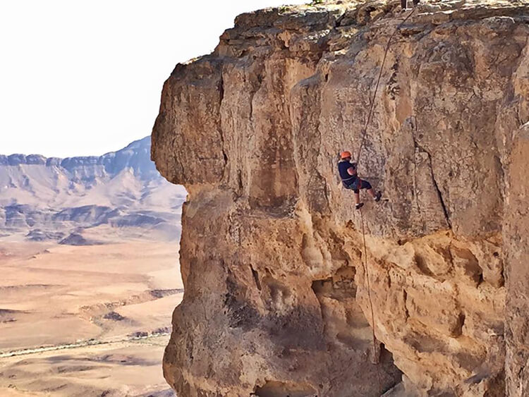 Rappelling at Ramon Crater in the Negev Desert