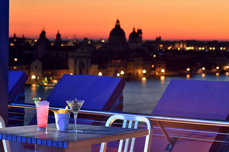 Sunset and Venice seen from the Sky Bar on the rooftop of the Molino Stucky