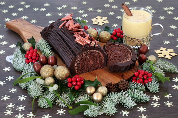 A chocolate yule log cake with eggnog