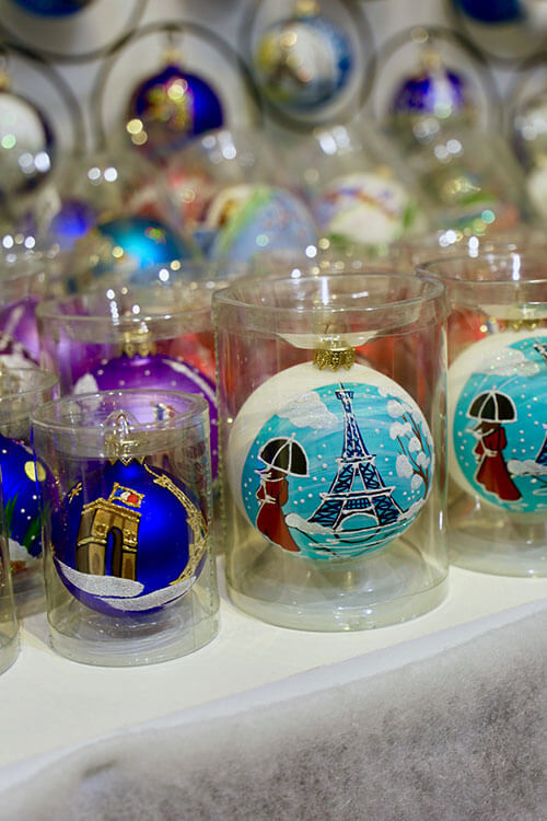 Christmas bulb ornaments painted with the Eiffel Tower found at a Christmas market in Paris, France