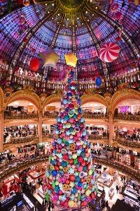 The Christmas tree in Galeries Lafayette decorated with candy decorations under the glass dome in Paris, France