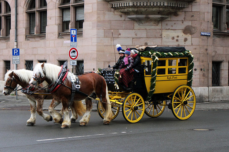Take a mail coach carriage ride around the Christkindlesmarkt