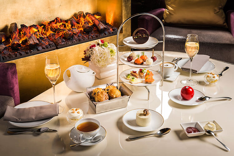 The afternoon tea service by a roaring fire in the Camelia restaurant at the Mandarin Oriental Paris